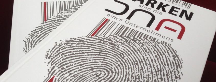 Buchumschlag perspektivisch –Manfred Enzlmüllers Marken sind die DNA eines Unternehmens